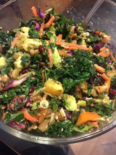 The Optimum Omega salad! Kale, parsley, orange peppers, shredded carrots, red cabbage, golden raisins, dried cranberries, flax seeds, chia seeds, sliced raw almonds, walnuts and avocados. Yummo!